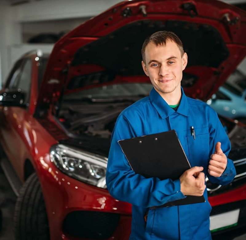 technician-with-notebook-car-with-opened-hood-small.jpg